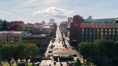 Kiev. Ukraine. June 9, 2017. Kyiv TSUM. Khreshchatyk. Aerial view TSUM. Streets. People. Road. Cars. Building. Trees. Summer. The sun is shining. On the roof rest people. City center. Traffic.