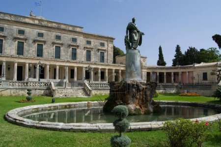 building with a sculpture and a fountain in the courtyard of Corfu, Greece.