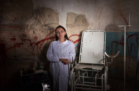 Female scientist in dungeon with bloody walls