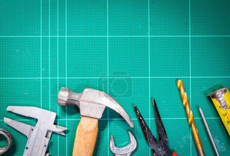 Photo for Tool kit renovation on green board - Royalty Free Image