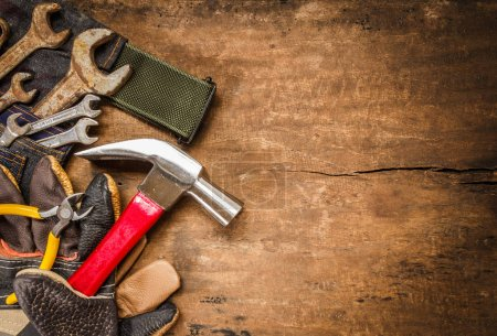 Photo for Tool renovation on brown wood background - Royalty Free Image