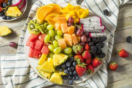 Photo for Raw Organic Fruit Platter with Berries Melons and Grapes - Royalty Free Image