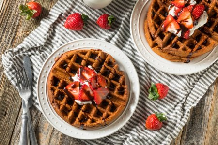 Photo for Homemade Dark Chocolate Waffles with Whipped Cream and Strawberries - Royalty Free Image
