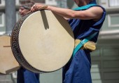 Japanese percussion drum being played during a march