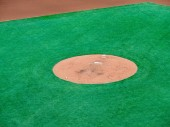 Pitcher's mound of a baseball diamond awaiting pitcher