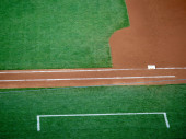 First base line and coach box of a baseball field