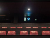 Movie theater film projector playing in an empty theater
