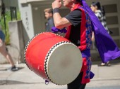 Man playing a wadaiko percussion drum as part of a Japanese para