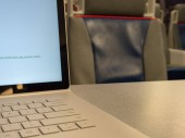 Close of a laptop keyboard on a traveling train