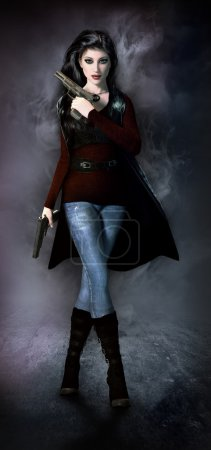 Photo for Woman in jeans, boots and long coat holding pistols. - Royalty Free Image