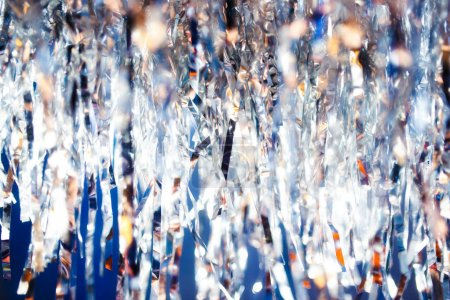 Silver serpentine shiny glitter background. Christmas and new year holiday concept.