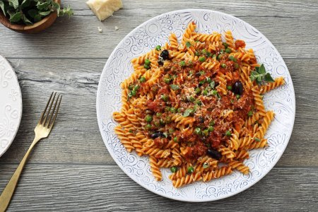 Photo for Fusilli pasta and bolognese sauce italian food dish on wooden table - Royalty Free Image