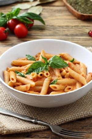 Pasta strascicata with tomato sauce and parmesan