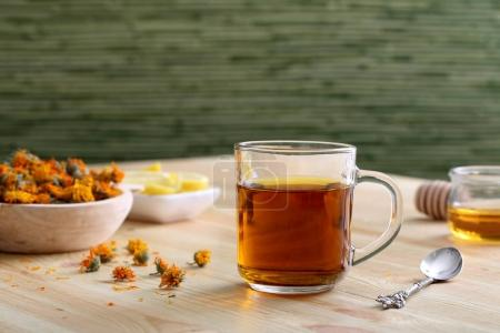 marigold flowers tea cup