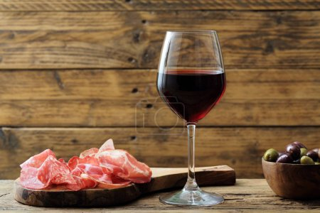 red wine glass rustic background