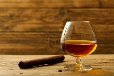 alcoholic drink in glass rustic background