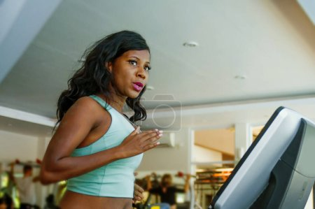 Indoors fitness center lifestyle  portrait of youn...