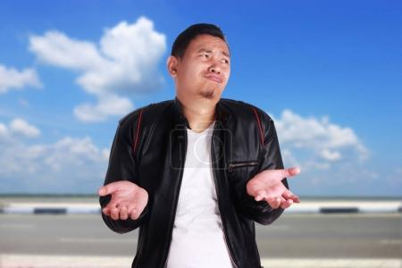 Young Asian Man Shrug Don't Know Gesture