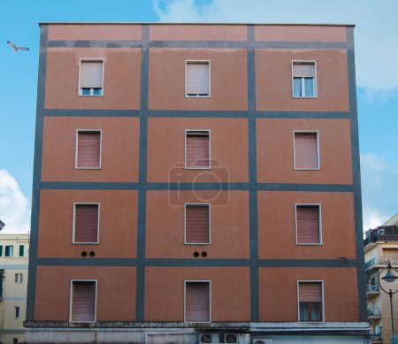 Photo for Facade of european building with shuttered windows under blue sky, Anzio, Italy - Royalty Free Image