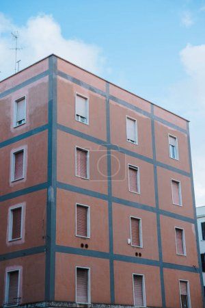 european building with shuttered windows under blue sky, Anzio, Italy