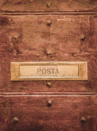 post signboard on doors in Orvieto, Rome suburb, Italy