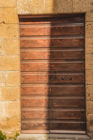 shadow on old wooden doors in Orvieto, Rome suburb, Italy