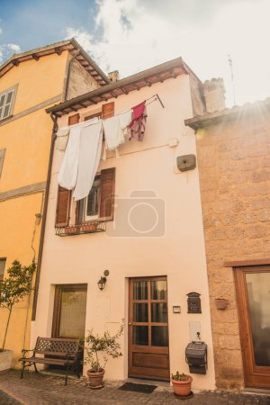 Photo for Clothes drying outside building in Orvieto, Rome suburb, Italy - Royalty Free Image