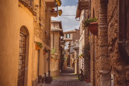 Photo for Narrow street and ancient buildings in Orvieto, Rome suburb, Italy - Royalty Free Image