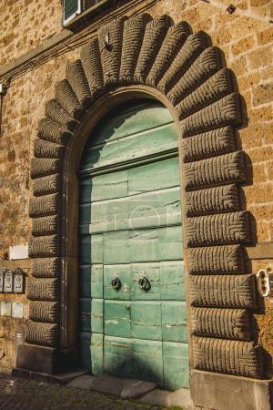 green wooden doors in Orvieto, Rome suburb, Italy