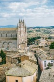 aerial view of ancient historical Orvieto Cathedral and roofs of buildings in Orvieto, Rome suburb, Italy