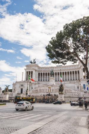 ROME, ITALY - 10 MARCH 2018: beautiful ancient building of Altare della Patria with cars and people on Piazza Venezia (Venezia Square)