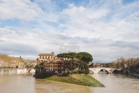 Photo for Beautiful Tiber Island on cloudy day, Rome, Italy - Royalty Free Image