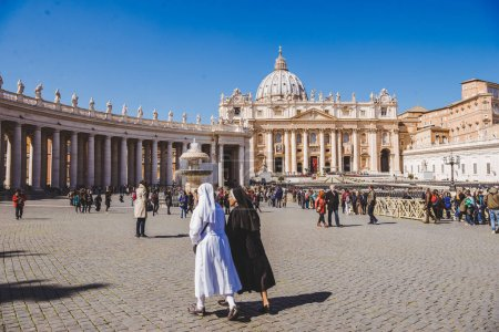 Photo for VATICAN, ITALY - 10 MARCH 2018: nuns walking by St. Peter's square - Royalty Free Image