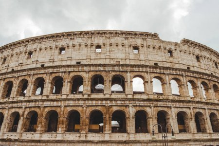 Photo for Ancient Colosseum ruins on cloudy day, Rome, Italy - Royalty Free Image