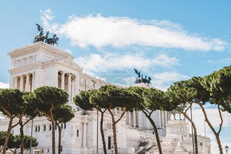 beautiful Altare della Patria (Altar of the Fatherland) with trees on foreground, Rome, Italy