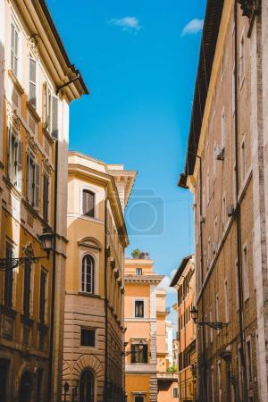ancient buildings on street of Rome on sunny day, Italy