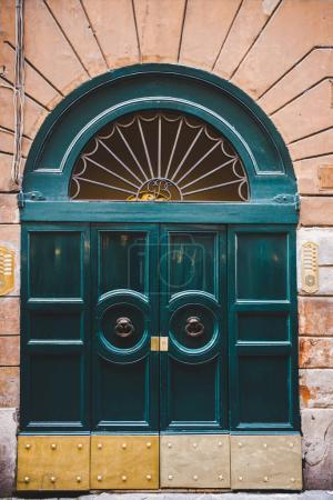 Photo for Old green doors in building in Rome, Italy - Royalty Free Image