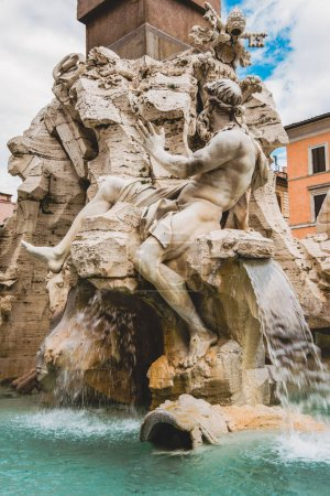 statues on ancient Fountain of Four Rivers in Rome, Italy