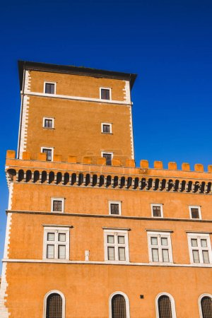 bottom view of orange building and blue sky in Rome, Italy