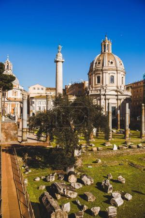 Photo for Santa Maria di Loreto (St Maria of Loreto) church at Roman Forum ruins in Rome, Italy - Royalty Free Image