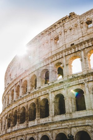 Photo for Ancient beautiful Colosseum ruins with sunshine in Rome, Italy - Royalty Free Image
