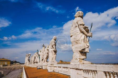 statues on top of St Peters Basilica, Vatican city, Italy