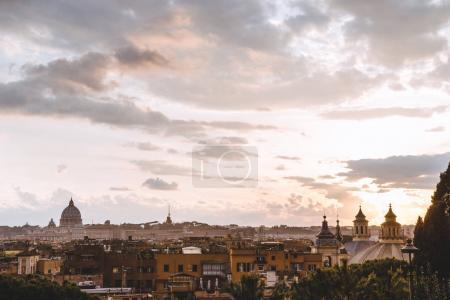 Photo for View of St Peters Basilica and cloudy sky during sunrise in Rome, Italy - Royalty Free Image