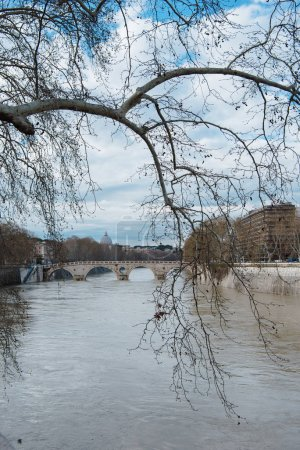 Photo for Bridge over tiber river on cloudy day, Rome, Italy - Royalty Free Image