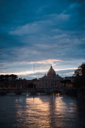 Photo for View of St Peters Basilica and buildings in Rome, Italy at evening - Royalty Free Image