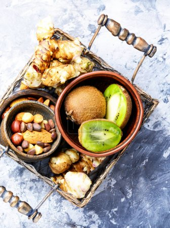 Photo for Healthy food concept with with Jerusalem artichoke, kiwi and nuts.Clean eating - Royalty Free Image