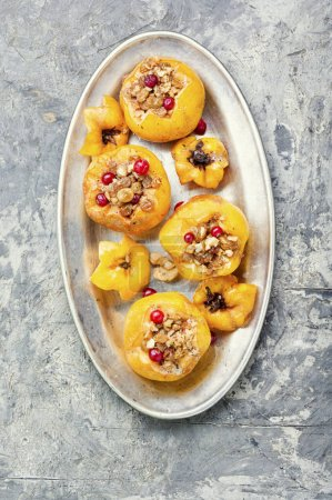 Photo for Quince stuffed with raisins and walnuts.Baked quince.Autumn food - Royalty Free Image
