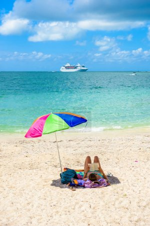Cruise ship on Caribbean Sea close to paradise beach. Tropical travel concept and destination for vacation. Recreation and relaxing.