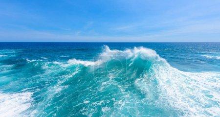 Closeup of turquoise splashing waves in daytime