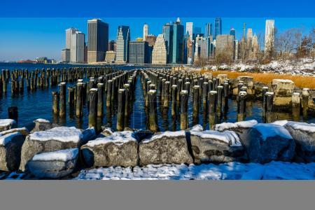 Lower Manhattan skyline panorama in snowy winter time, New York City, USA.